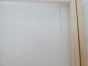 アリワークの刺繍枠に生地が張ってあります。