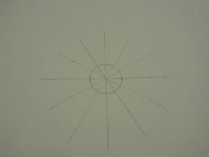 等分に分けた印を、中心を通って対角線に結んでいます