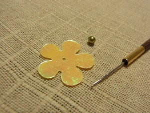 花形スパンコール、ビーズ、アリワークの針があります。