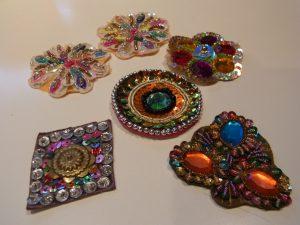 インドのお土産です。花形、円形、ひし形のパーツにスパンコールとビーズ、モールが刺してあります。
