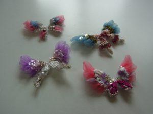 羽根がオーガンジーの小さくて可愛い蝶々です。