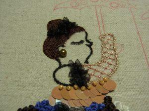 髪型の刺した境目に、オーガンジーリボンをフリルのように飾っています。