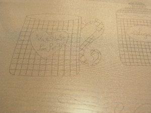 生地にコーヒーカップがのデザイン生地に書いてあります。