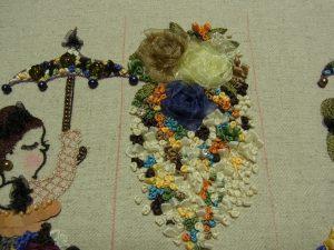 オーガンジーリボンの薔薇の周りに多くのリボン刺繍をしています。